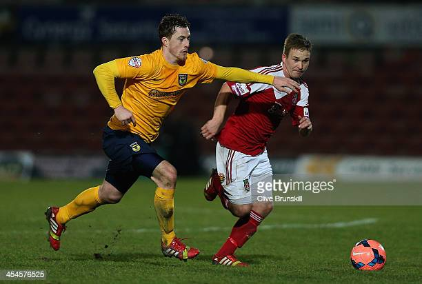 Jay Harris of Wrexham AFC attempts to move away from a challenge by Scott Davies of Oxford United during the FA Cup Second Round match between...