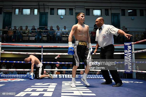 Jay Harris ordered to the corner of the ring by referee Ian Jon Lewis after he knocked down whilst Tibor Nador during their Super Bantamweight...