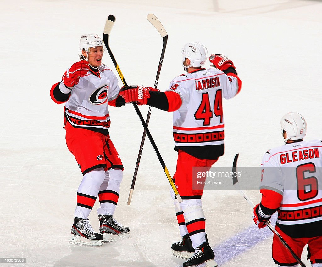 Jay Harrison #44 and Alexander Semin #28 of the Carolina Hurricanes celebrate Harrison's game winning goal against the Buffalo Sabres at First Niagara Center on January 25, 2013 in Buffalo, New York. Carolina won 3-1.