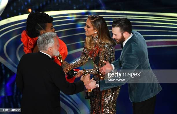 Jay Hart and Hannah Beachler accept the Production Design award for 'Black Panther' from Jennifer Lopez and Chris Evans onstage during the 91st...
