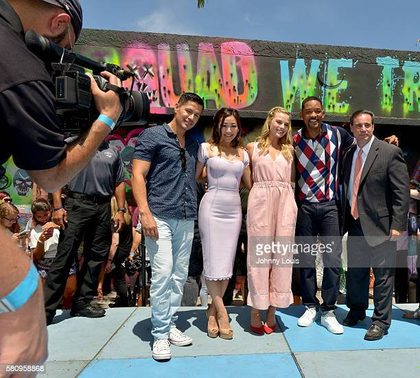 Jay Hernandez, Karen Fukuhara, Margot Robbie and Will Smith attend the 'Suicide Squad' Wynwood Block Party and Mural Reveal with cast on July 25,...