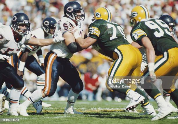 Jay Hilgenberg Center for the Chicago Bears blocks Bob Nelson Nose Tackle for the Green Bay Packers during the National Football Conference Central...