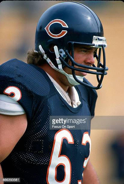 Jay Hilgenberg of the Chicago Bears looks on from the sidelines during an NFL football game circa 1989 at Soldier Field in Chicago Illinois...