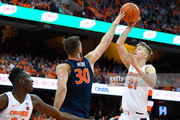 Jay Huff of the Virginia Cavaliers alters the shot of Marek Dolezaj of the Syracuse Orange during the second half at the Carrier Dome on November 6...