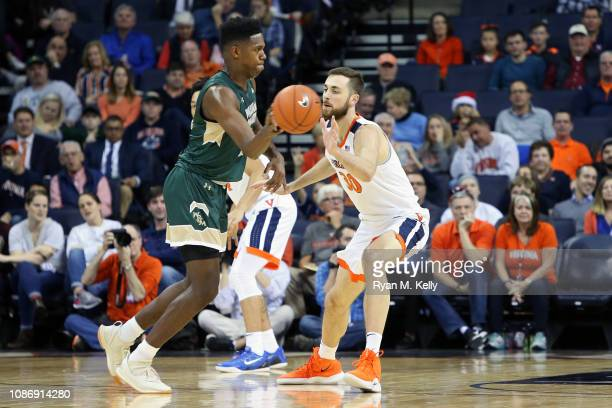 Jay Huff of the Virginia Cavaliers defends Nathan Knight of the William & Mary Tribe in the first half during a game at John Paul Jones Arena on...