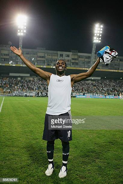 Jay Jay Okocha of Bolton celebrates at the final whistle during the UEFA Cup 1st round second leg match between and Lokomotiv Plovdiv and Bolton...