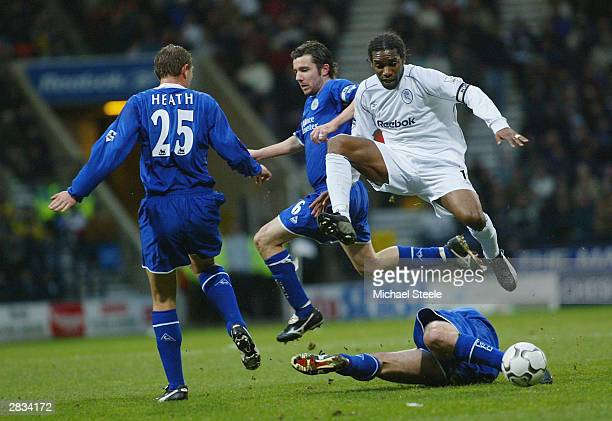 Jay Jay Okocha of Bolton leaps above Callum Davidson as Muzzy Izzet challenges during the FA Barclaycard Premiership match between Bolton Wanderers...