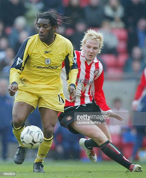 Jay Jay Okocha of Bolton Wanderers battles with Sean Thornton of Sunderland during the FA Barclaycard Premiership match between Sunderland and Bolton...