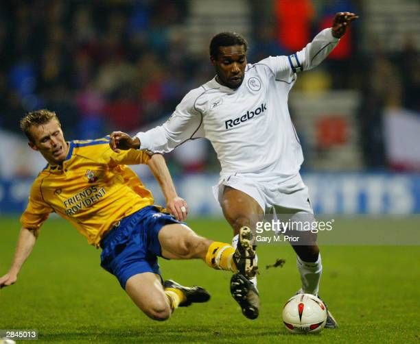 Jay Jay Okocha of Bolton Wanderers is tackled by Brett Ormerod of Southampton during the Carling Cup Quarter Final match between Bolton Wanderers and...
