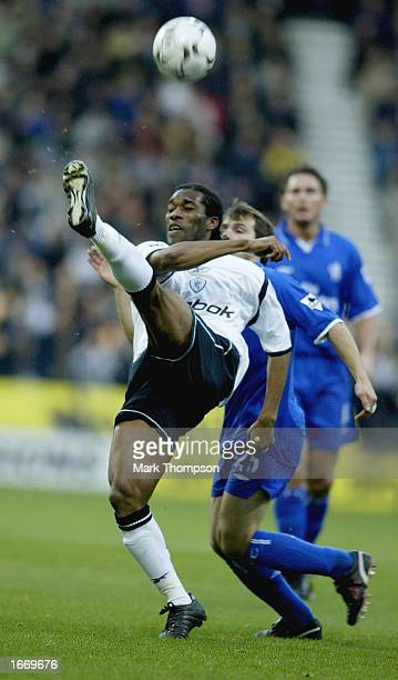 Jay Jay Okocha of Bolton Wanderers is watched by Gianfranco Zola od Chelsea during the FA Barclaycard Premiership match between Bolton Wanderers and...