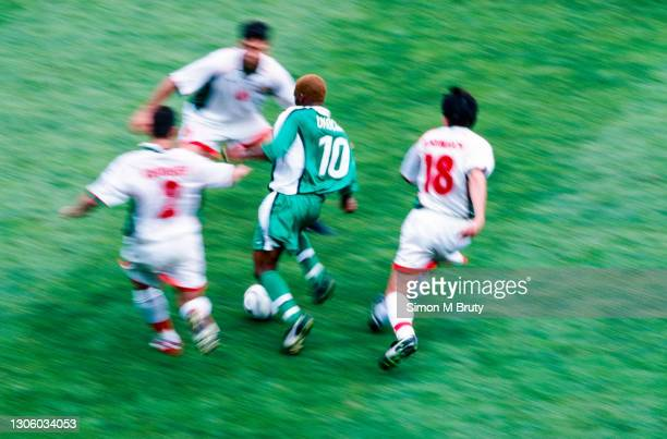Jay Jay Okocha of Nigeria in action during the World Cup 1st round match between Nigeria and Bulgaria at the Parc des Princes, France on June 19,...
