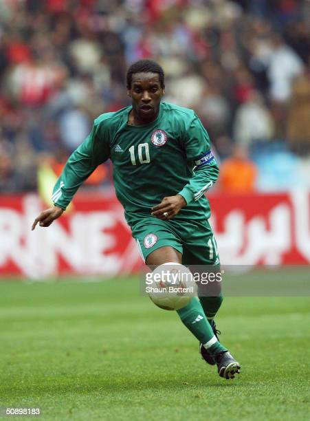 Jay Jay Okocha of Nigeria runs with the ball during the African Nations Cup 2004 SemiFinal match between Tunisia and Nigeria held at the Olympic...