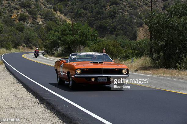 Jay Jeffs and Sara Jeffs drive a 1970 Plymouth Cuda convertible drives during the Friends of Steve McQueen Car Show Rally from Camarillo to the Pine...