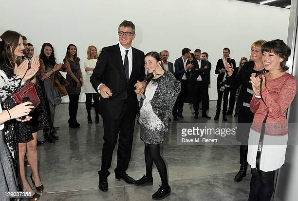 Jay Jopling helps daughter Angelica cut the ribbon at the opening of the new White Cube Bermondsey gallery on October 11 2011 in London England