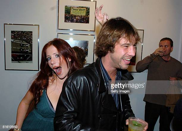 Jay Kay from Jamiroquai and actress Amy Nuttall attend the private view for 'Carrera 1964 2004 40 Years Of Legend' at the Getty Images Gallery on...