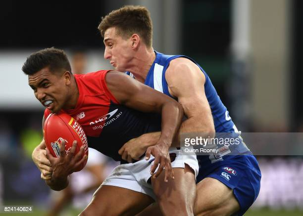 Jay KennedyHarris of the Demons is tackled by Shaun Atley of the Kangaroos during the round 19 AFL match between the North Melbourne Kangaroos and...