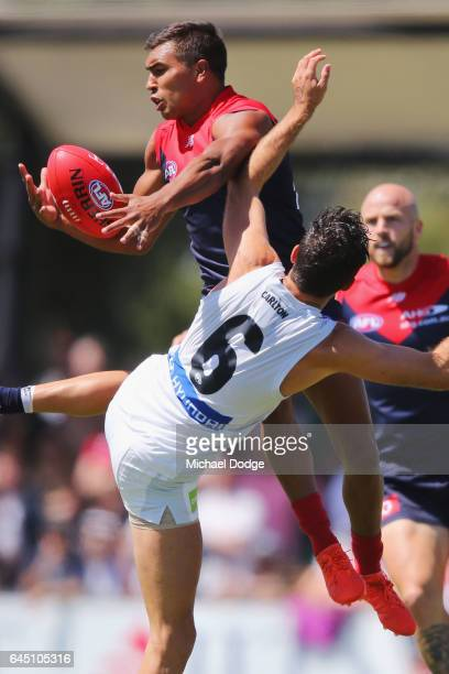 Jay Kennedy-Harris of the Demons marks the ball over Kade Simpson of the Blues during the JLT Community Series AFL match between the Melbourne Demons...