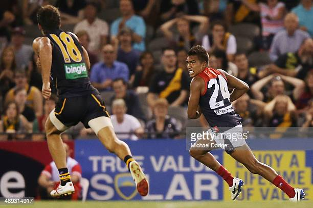 Jay KennedyHarris of the Demons runs with the ball to kick a goal during the round one AFL NAB Challenge Cup match between the Richmond Tigers and...