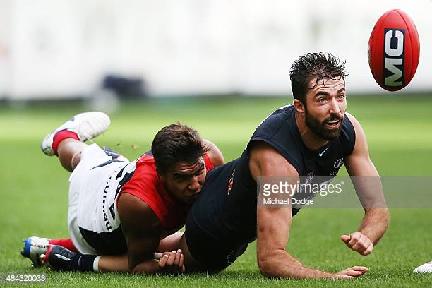Jay KennedyHarris tackles Kade Simpson of the Blues during the round four AFL match between the Carlton Blues and the Melbourne Demons at Melbourne...