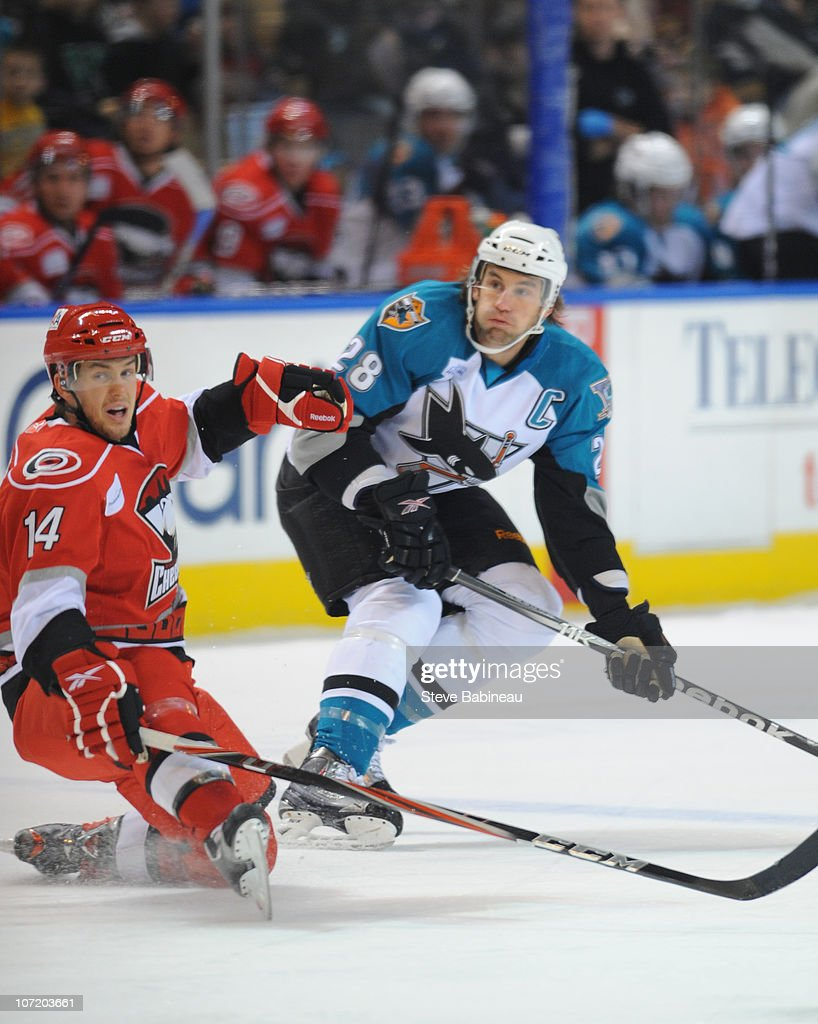 Jay Leach #28 of the Worcester Sharks takes a shot against Brett Sutter #14 of the Charlotte Checkers at the DCU Center on November 27, 2010 in Worcester Massachusetts.