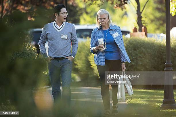 Jay Lee vice chairman of Samsung Electronics Limited walks with Ginni Rometty president and chief executive officer of IBM as they attend the annual...