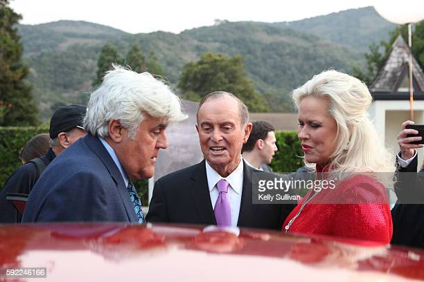 Jay Leno racing legend Bob Bondurant and his wife Patricia Bondurant socialize at Folktale Winery on August 19 2016 in Carmel California