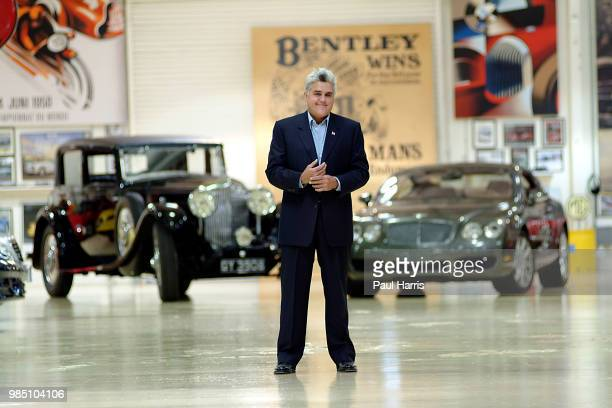 Jay Leno stands in one of his 3 car storage facilities with a 1931 Straight 8 Bentley he owns and a 2004 Bentley S2 American Television personality...