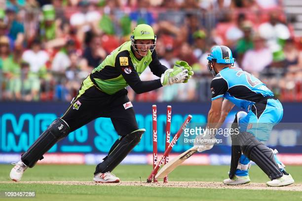 Jay Lenton of the Thunder stumps Jon Wells of the Strikers during the Big Bash League match between the Sydney Thunder and the Adelaide Strikers at...