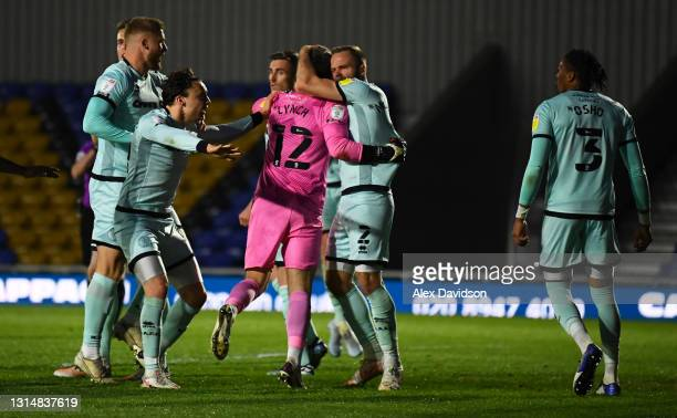 Jay Lynch of Rochdale is congratulated by team mates as he saves a penalty from Joe Pigott of AFC Wimbledon during the Sky Bet League One match...