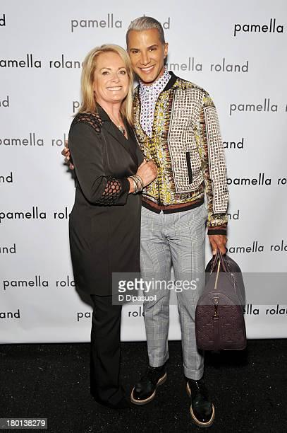 Jay Manuel and designer Pamella Roland pose backstage at the pamella roland Spring 2014 fashion show during MercedesBenz Fashion Week on September 9...
