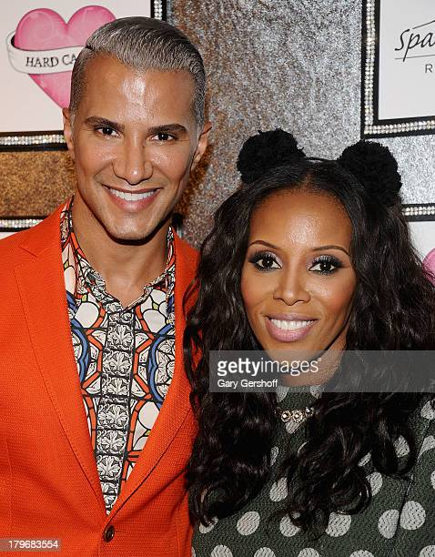 Jay Manuel and June Ambrose pose at the GBK Sparkling Resort Fashionable Lounge during MercedesBenz Fashion Week on September 6 2013 in New York City