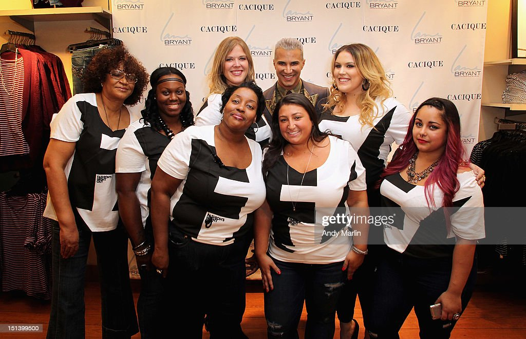 Jay Manuel and Lane Bryant sales associates show off the Fashion Night Out shirts during Fashion Guru Jay Manuel Hosts Lane Bryant's Fashion Night Out on September 6, 2012 in Brooklyn, New York.