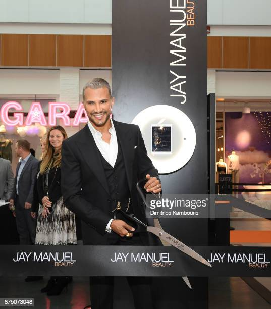 Jay Manuel cuts the ribbon during Jay Manuel Beauty Grand Opening at Roosevelt Field Mall on November 16 2017 in Garden City City