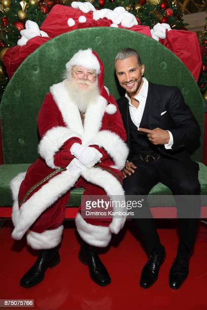 Jay Manuel takes a photo with Santa Claus during Jay Manuel Beauty Grand Opening at Roosevelt Field Mall on November 16 2017 in Garden City City