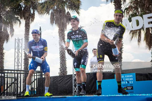 Jay McCarthy Elia Viviani and Daryl Impey celebrate their placings after the 2018 Cadel Evans Great Ocean Road Race on January 28 2018 in Geelong...