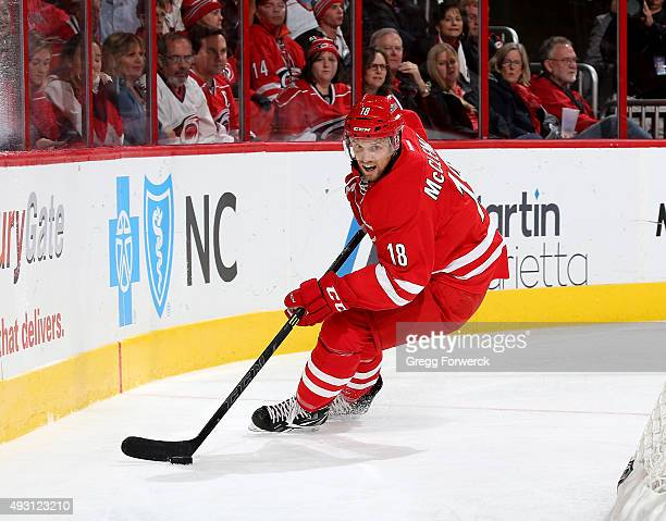 Jay McClement of the Carolina Hurricanes controls the puck behind the net during a NHL game against the Detroit Red Wings at PNC Arena on October 10...
