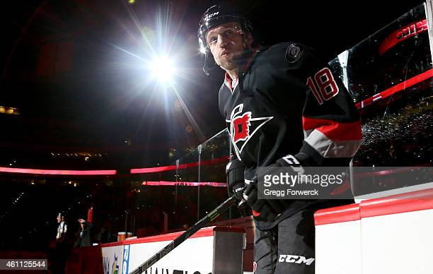 Jay McClement of the Carolina Hurricanes enters the ice prior to their NHL game against the Boston Bruins at PNC Arena on January 4 2015 in Raleigh...