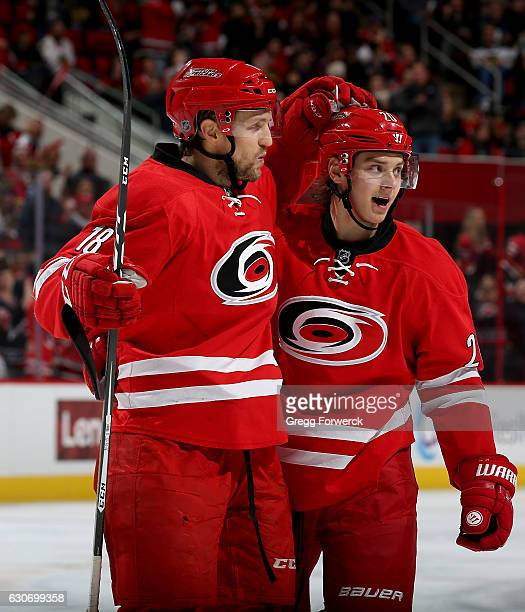 Jay McClement of the Carolina Hurricanes is congratulated by teammate Sebastian Aho after scoring during an NHL game against the Chicago Blackhawks...