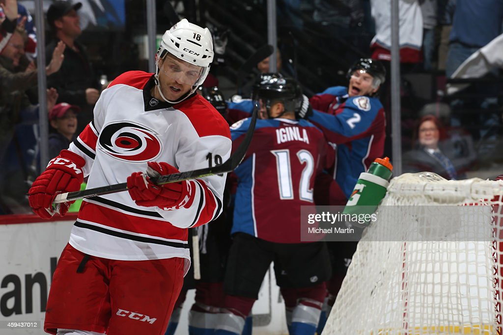 Jay McClement #18 of the Carolina Hurricanes reacts as Nick Holden #2 and Jarome Iginla #12 of the Colorado Avalanche celebrate the go-ahead goal scored late in the third period at the Pepsi Center on November 22, 2014 in Denver, Colorado. The Avalanche defeated the Hurricanes 4-3.