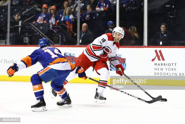 Jay McClement of the Carolina Hurricanes skates against Thomas Hickey of the New York Islanders during their game at the Barclays Center on March 13...