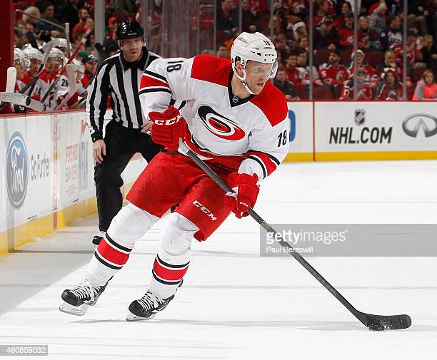 Jay McClement of the Carolina Hurricanes skates in an NHL hockey game against the New Jersey Devils at Prudential Center on December 23 2014 in...