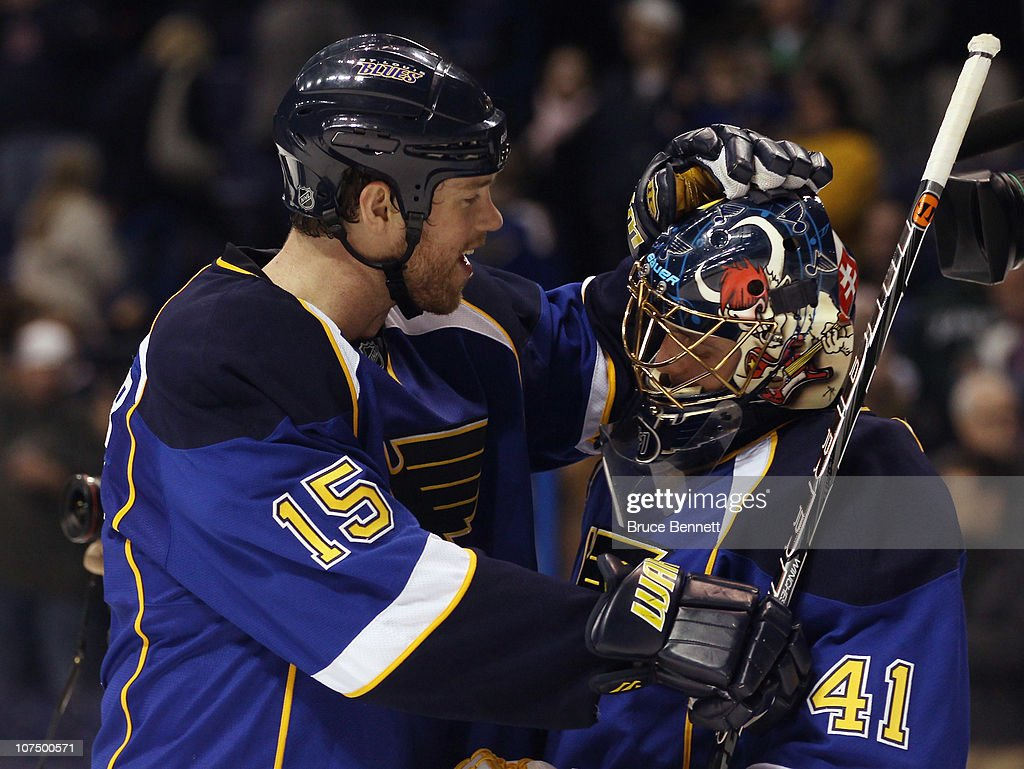 Jay McClement #18 of the St. Louis Blues congratulates Jaroslav Halak #41 following a game against the Columbus Blue Jackets at the Scottrade Center on December 9, 2010 in St Louis, Missouri. The Blues defeated The Blue Jackets 4-1.