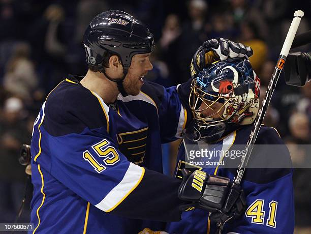 Jay McClement of the St Louis Blues congratulates Jaroslav Halak following a game against the Columbus Blue Jackets at the Scottrade Center on...