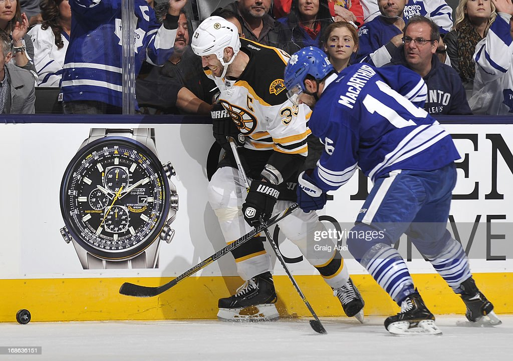 Jay McClement #11 of the Toronto Maple Leafs battles for the puck with Zdeno Chara #33 of the Boston Bruins in Game Six of the Eastern Conference Quarterfinals during the 2013 NHL Stanley Cup Playoffs May 12, 2013 at the Air Canada Centre in Toronto, Ontario, Canada.