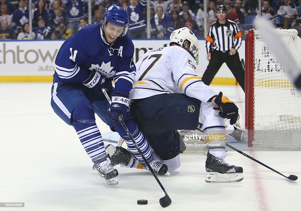 Jay McClement #11 of the Toronto Maple Leafs circles out in front of the Buffalo Sabres net during NHL action at First Niagara Center on January 29, 2013 in Buffalo, New York.