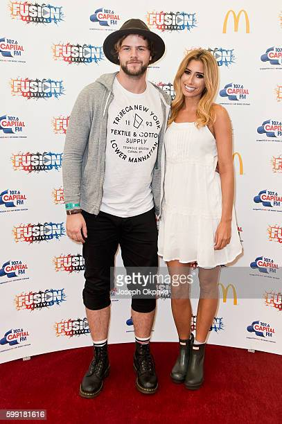 Jay McGuiness and Stacey Solomon pose backstage at Fusion Festival at Otterspool Parade on September 3 2016 in Liverpool England