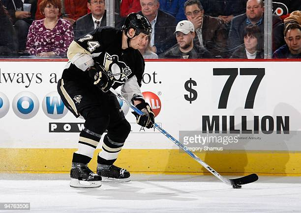 Jay McKee of the Pittsburgh Penguins controls the puck against the Philadelphia Flyers on December 15 2009 at Mellon Arena in Pittsburgh Pennsylvania
