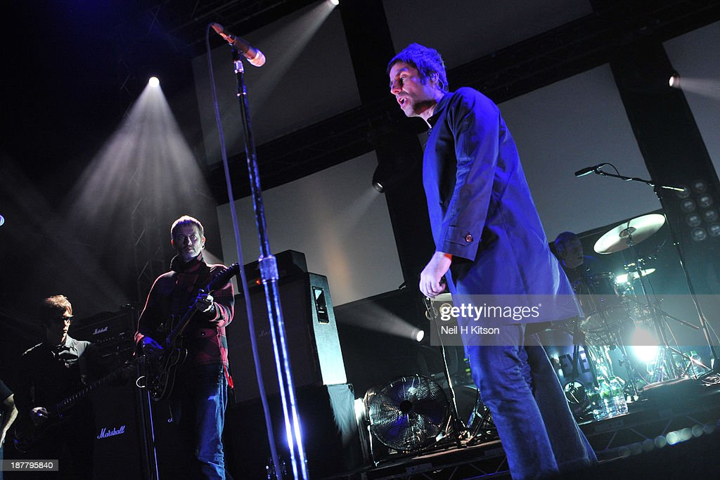 Jay Mehler, Andy Bell, Liam Gallagher and Chris Sharrock of Beady Eye performs on stage at O2 Academy on November 12, 2013 in Leeds, England.
