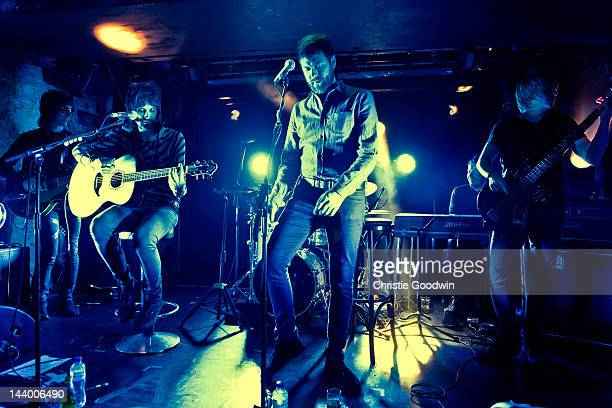 Jay Mehler Sergio Pizzorno Tom Meighan Ian Matthews and Chris Edwards of Kasabian perform a secret gig for Absolute Radio at The Box Soho on April 30...