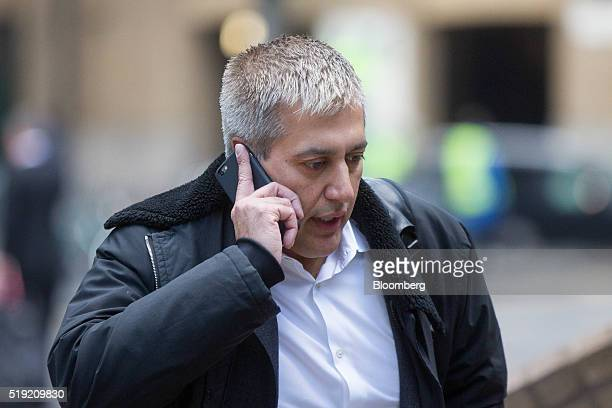 Jay Merchant a former trader at Barclays Plc speaks on his mobile phone as he arrives at Southwark Crown Court in London UK on Tuesday April 5 2016...